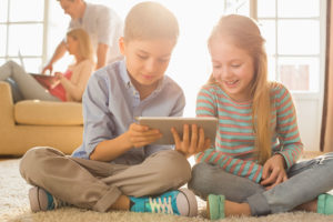 Kids holding a tablet computer